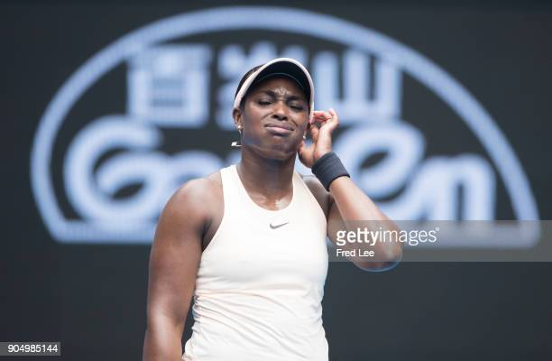 Sloane Stephens of the United States reacts during her first round match against Shuai Zhang of China on day one of the 2018 Australian Open at...