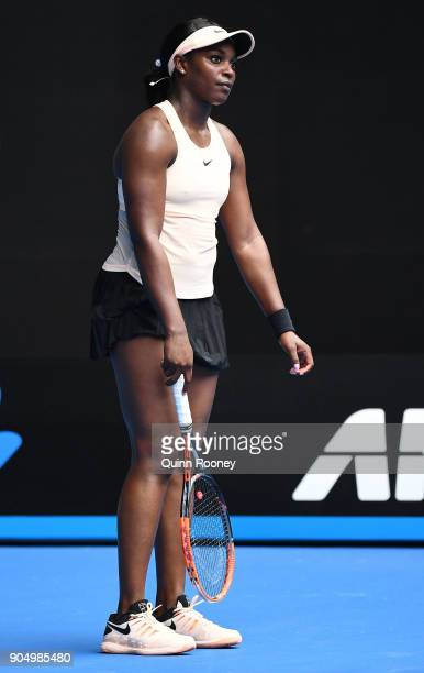 Sloane Stephens of the United States reacts in her first round match against Shuai Zhang of China on day one of the 2018 Australian Open at Melbourne...