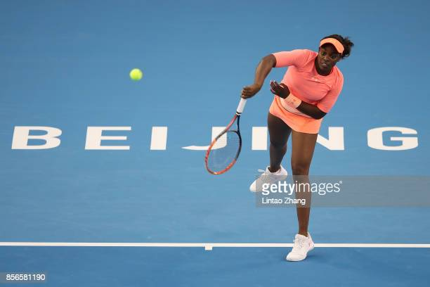 Sloane Stephens of the United States returns a shot against Christina McHale of the United States during the women's singles first round on day three...