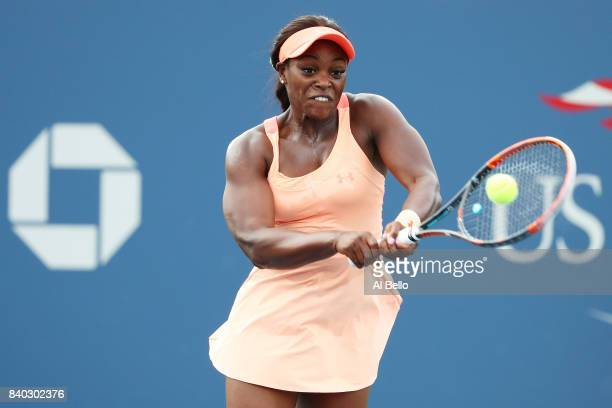 Sloane Stephens of the United States returns a shot during her first round Women's Singles match against Roberta Vinci of Italy on Day One of the...