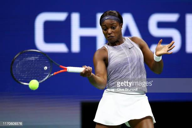 Sloane Stephens of the United States returns a shot during her Women's Singles first round match against women's Anna Kalinskaya of Russia on day two...