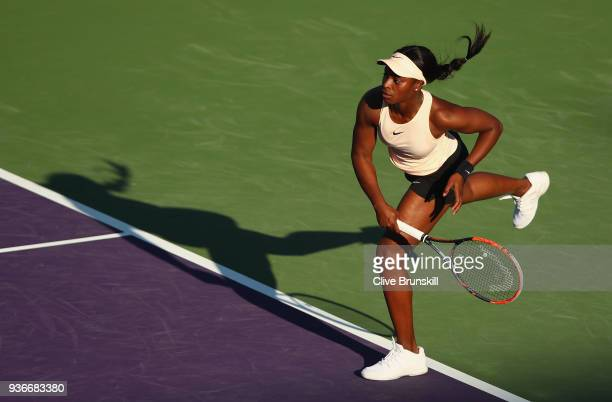 Sloane Stephens of the United States serves against Ajla Tomljanovic of Australia in their second round match during the Miami Open Presented by Itau...