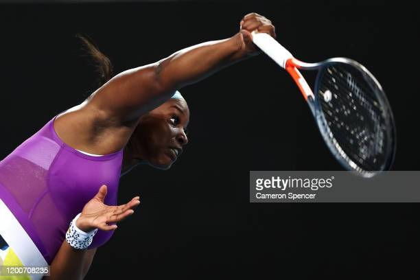 Sloane Stephens of the United States serves during her Women's Singles first round match against Shuai Zhang of China on day one of the 2020...