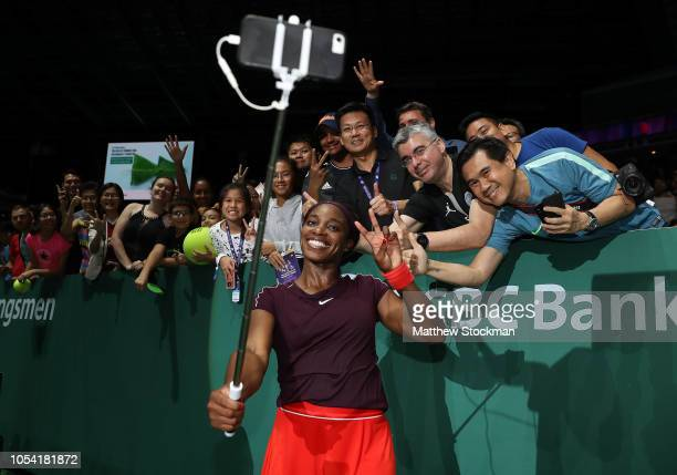 Sloane Stephens of the United States takes selfies with fans after her match against Karolina Pliskova of the Czech Republic during the women's...