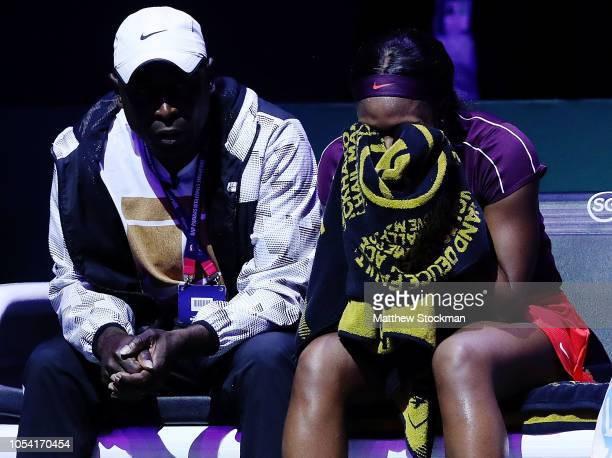 Sloane Stephens of the United States talks with her coach during the break against Karolina Pliskova of the Czech Republic during the women's singles...