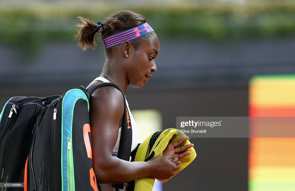 Sloane Stephens of the United States walks off dejected after her straight sets defeat against Serena Williams of USA in their second round match during day three of the Mutua Madrid Open tennis tournament at the Caja Magica on May 4, 2015 in Madrid, Spain.