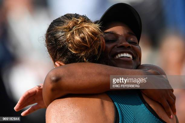 TOPSHOT Sloane Stephens of the US and Madison Keys the US embrace at the end of their women's singles semifinal match on day twelve of The Roland...