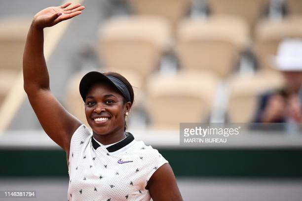 Sloane Stephens of the US celebrates after winning against Japan's Misaki Doi during their women's singles first round match on day 1 of The Roland...