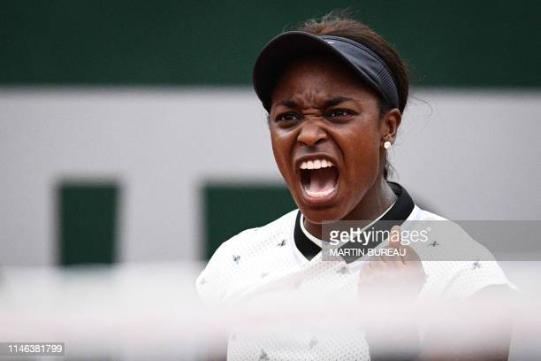 TOPSHOT Sloane Stephens of the US celebrates after winning against Japan's Misaki Doi during their women's singles first round match on day 1 of The...