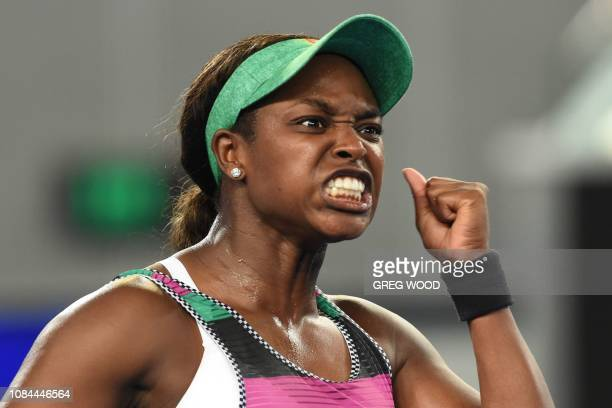 TOPSHOT Sloane Stephens of the US celebrates his victory against Croatia's Petra Martic during their women's singles match on day five of the...