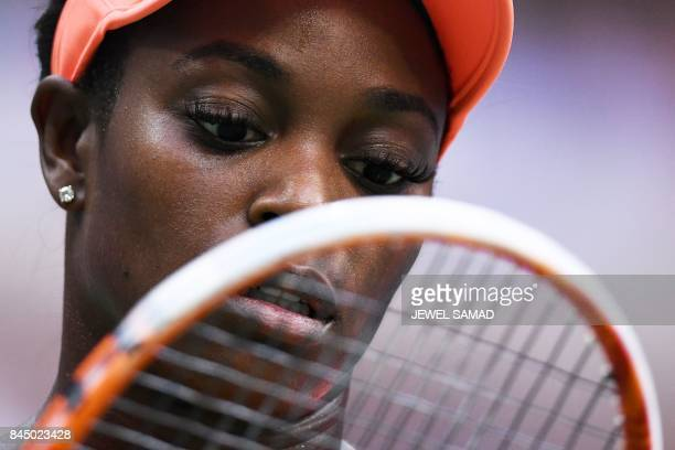 Sloane Stephens of the US checks her racket as she plays against compatriot Madison Keys during their 2017 US Open Women's Singles final match at the...