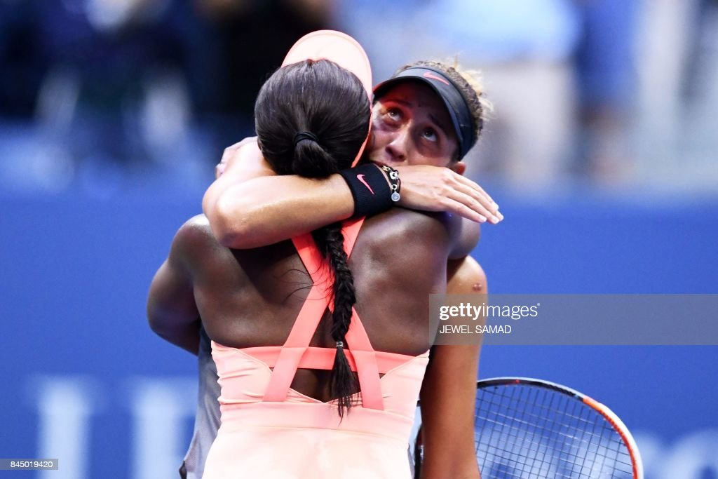 Sloane Stephens (L) of the US embraces compatriot Madison Keys after winning during their 2017 US Open Women's Singles final match at the USTA Billie Jean King National Tennis Center in New York on September 9, 2017. Sloane Stephens, sidelined for 11 months by a left foot injury until returning in July, captured her first Grand Slam title by routing fellow American Madison Keys 6-3, 6-0 in Saturday's US Open final. / AFP PHOTO / Jewel SAMAD