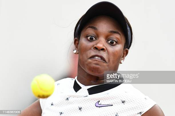 TOPSHOT Sloane Stephens of the US eyes the ball as she hits a return to Japan's Misaki Doi during their women's singles first round match on day 1 of...