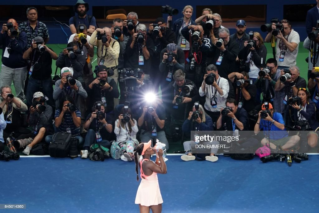 Sloane Stephens of the US kisses her winning trophy after defeating compatriot Madison Keys in their 2017 US Open Women's Singles final match at the USTA Billie Jean King National Tennis Center in New York on September 9, 2017. Sloane Stephens, sidelined for 11 months by a left foot injury until returning in July, captured her first Grand Slam title by routing fellow American Madison Keys 6-3, 6-0 in Saturday's US Open final. /