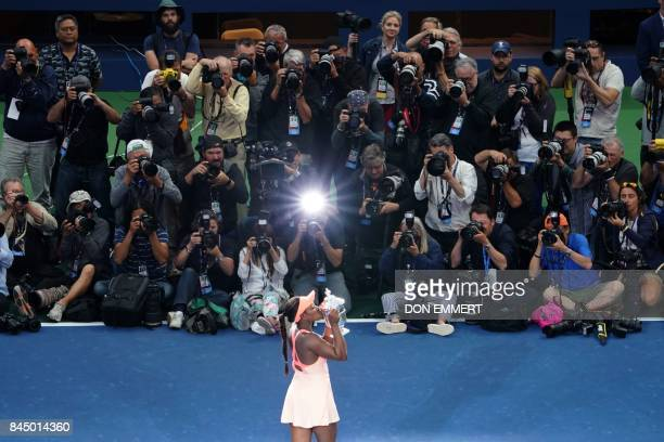 Sloane Stephens of the US kisses her winning trophy after defeating compatriot Madison Keys in their 2017 US Open Women's Singles final match at the...
