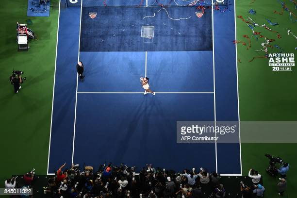 TOPSHOT Sloane Stephens of the US poses with her winning trophy after defeating compatriot Madison Keys in their 2017 US Open Women's Singles final...