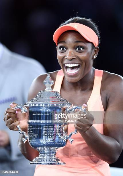 Sloane Stephens of the US reacts with winning trophy after defeating compatriot Madison Keys in their 2017 US Open Women's Singles final match at the...
