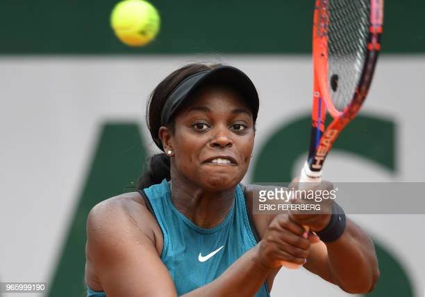 Sloane Stephens of the US returns the ball to Italy's Camila Giorgi during their women's singles third round match on day seven of The Roland Garros...