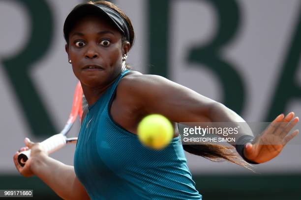 TOPSHOT Sloane Stephens of the US returns the ball to Madison Keys the US during their women's singles semifinal match on day twelve of The Roland...