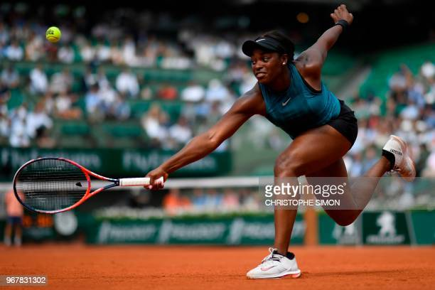 TOPSHOT Sloane Stephens of the US returns the ball to Russia's Daria Kasatkina during their women's singles quarterfinal match on day ten of The...