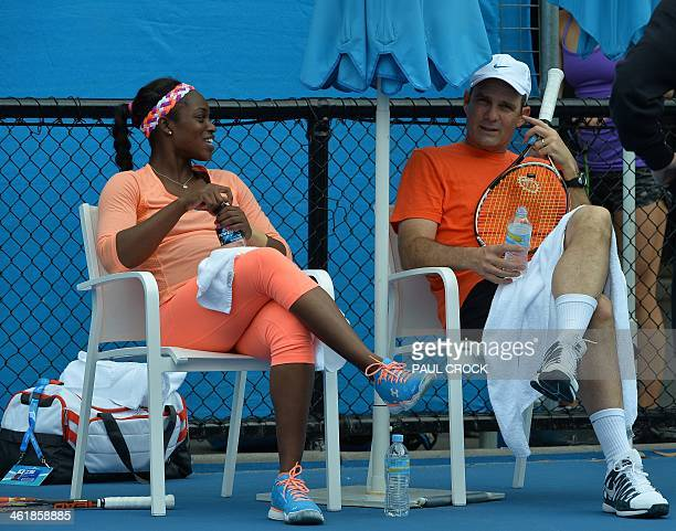 Sloane Stephens of the US speaks with a coach during a practice session ahead of the 2014 Australian Open tennis tournament in Melbourne on January...