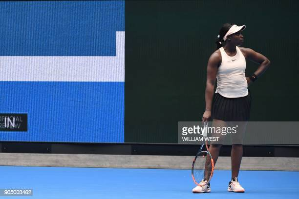 Sloane Stephens of the US watches a review after a point against China's Zhang Shuai during their women's singles first round match on day one of the...