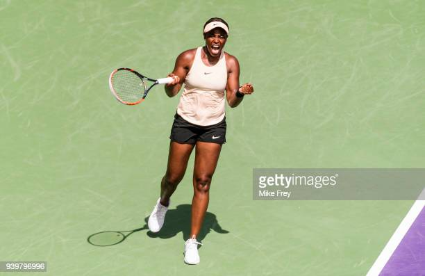 Sloane Stephens of the USA celebrates beating Victoria Azarenka of Belarus 3-6 6-2 6-1 during the semifinals match on Day 11 of the Miami Open...
