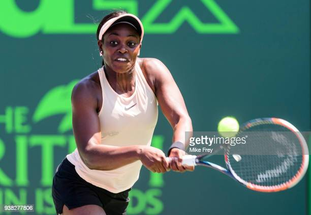 Sloane Stephens of the USA hits a backhand against Garbine Muguruza of Spain during their match on Day 8 of the Miami Open Presented by Itau at...