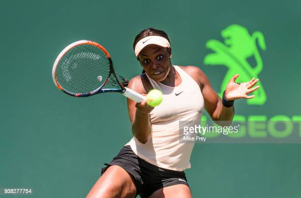 Sloane Stephens of the USA hits a forehand against Garbine Muguruza of Spain during their match on Day 8 of the Miami Open Presented by Itau at...