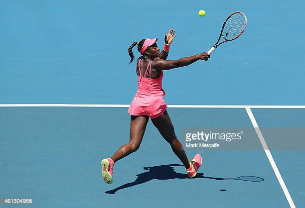 Sloane Stephens of the USA plays a backhand volley in her first round match against Monica Niculescu of Romania during day one of the 2015 Hobart...