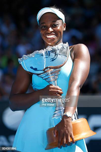Sloane Stephens of the USA poses with the trophy after winning her singles final match against Julia Joerges of Germany during day six of the 2016...