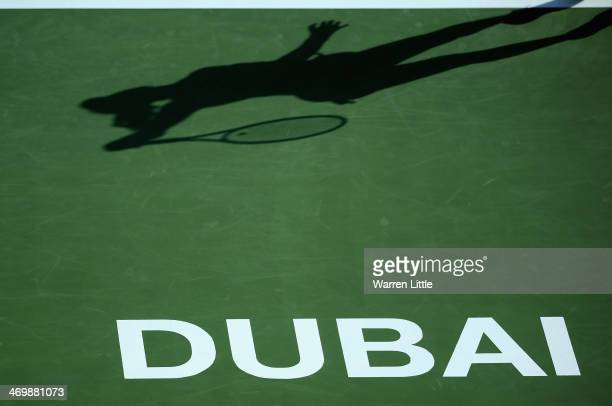Sloane Stephens of the USA serves in her match against Lucie Safarova of the Czech Republic during day one of the WTA Dubai Duty Free Tennis...