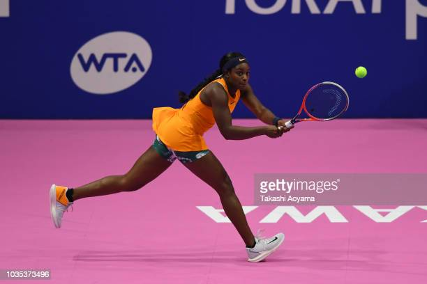 Sloane Stephens of United States plays a backhand against Donna Vekic of Croatia during their Women's singles first round match on day two of the...