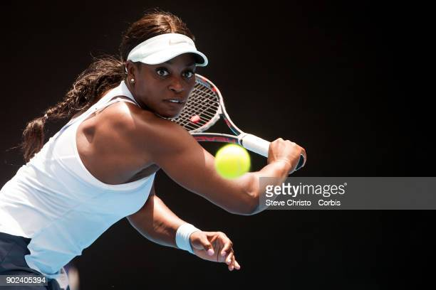 Sloane Stephens of United States plays a backhand in her first round match against Camila Giorgi of Italy during day one of the 2018 Sydney...