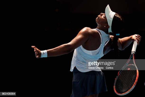 Sloane Stephens of United States serves in her first round match against Camila Giorgi of Italy during day one of the 2018 Sydney International at...