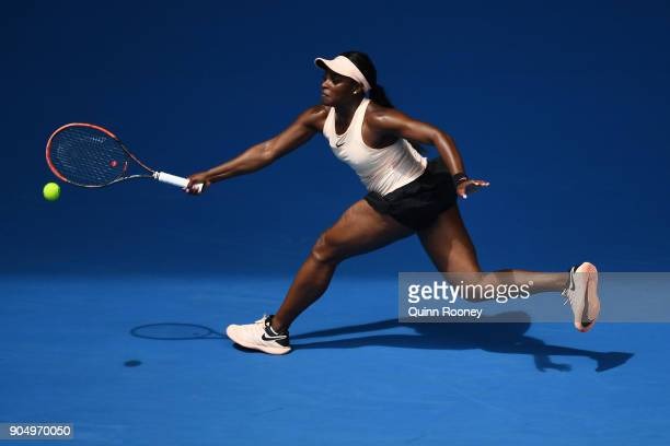 Sloane Stephens of USA plays a forehand in her first round match against Shuai Zhang of China on day one of the 2018 Australian Open at Melbourne...
