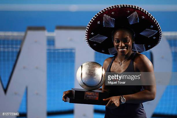 Sloane Stephens of USA poses for pictures after winning the woman's final singles match between Dominika Cibulkova of Slovakia and Sloane Stephens of...