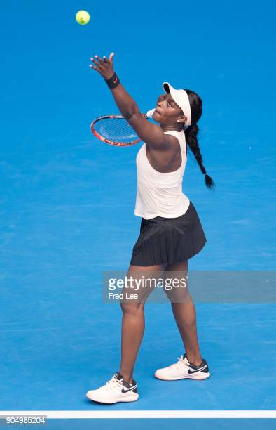 Sloane Stephens of USA serves in her first round match against Shuai Zhang of China on day one of the 2018 Australian Open at Melbourne Park on...