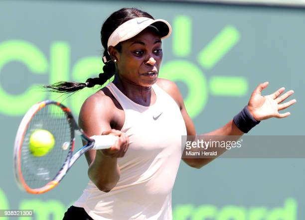 Sloane Stephens returns a ball hit by Garbine Muguruza at the Miami Open on Monday March 26 2018 on Key Biscayne Fla