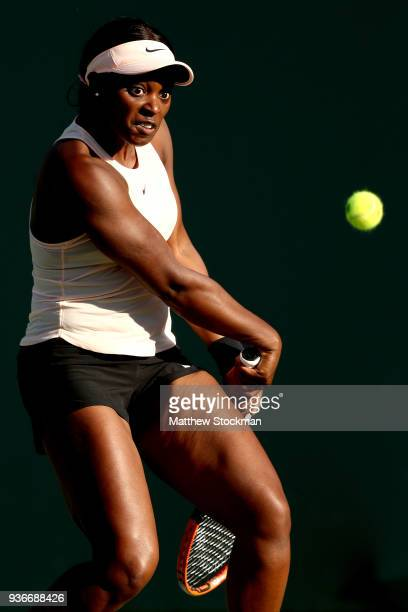 Sloane Stephens returns a shot to Ajia Tomljanovic of Australia during Day 4 of the Miami Open at the Crandon Park Tennis Center on March 22 2018 in...