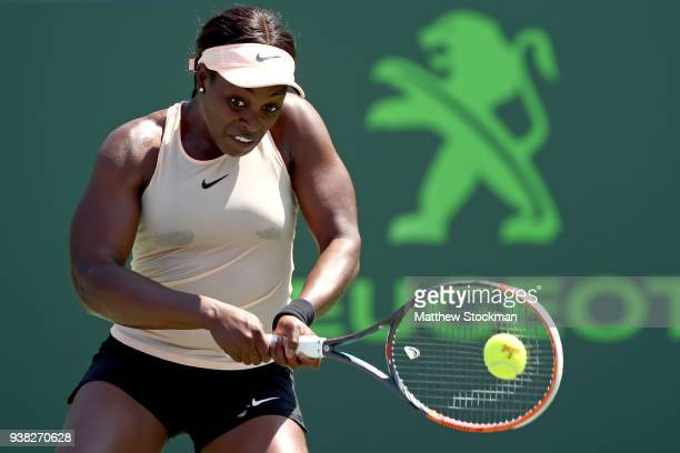 Sloane Stephens returns a shot to Garbine Muguruza of Spain during the Miami Open Presented by Itau at Crandon Park Tennis Center on March 26 2018 in...