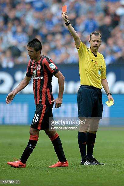 Slobodan Medojevic of Frankfurt is sent off the pitch by referee Markus Schmidt during the Bundesliga match between FC Schalke 04 and Eintracht...