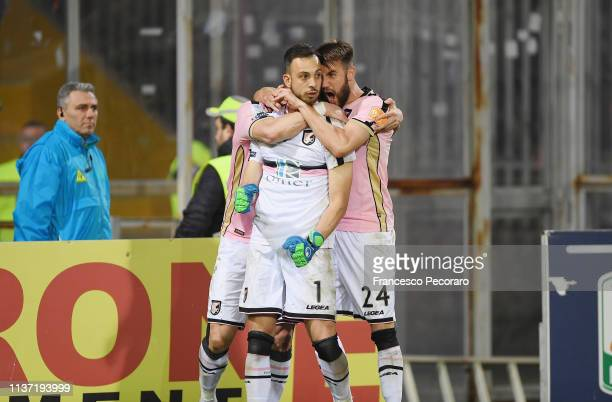 Slobodan Rajkovic, Alberto Brignoli and Przemyslaw Szyminski celebrate the victory after the Serie B match between Benevento and Carpi FC at Stadio...