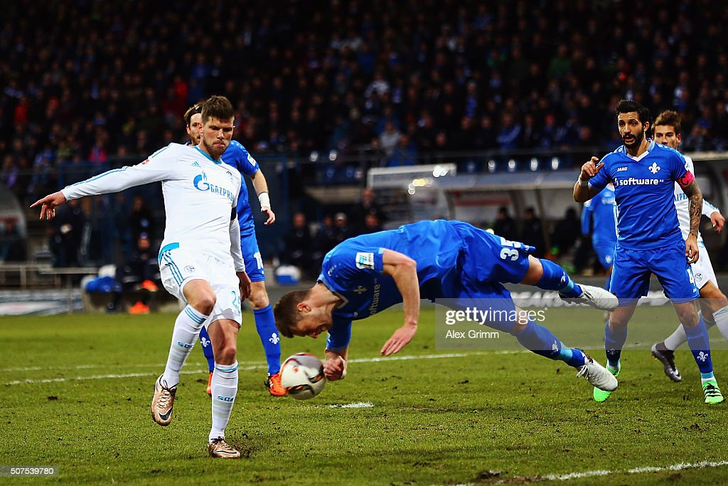 Slobodan Rajkovic of Darmstadt heads the ball next to Klaas-Jan Huntelaar of Schalke during the Bundesliga match between SV Darmstadt 98 and FC Schalke 04 at Merck-Stadion am Boellenfalltor on January 30, 2016 in Darmstadt, Germany.