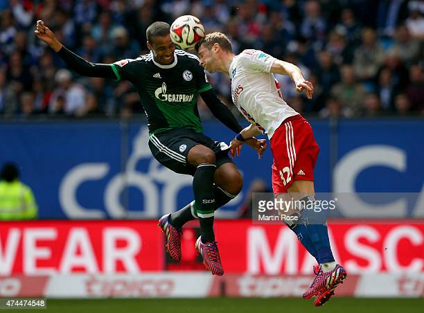 Slobodan Rajkovic of Hamburg and Joel Matip of Schalke battle for the ball during the Bundesliga match between Hamburger SV and FC Schalke 04 at...