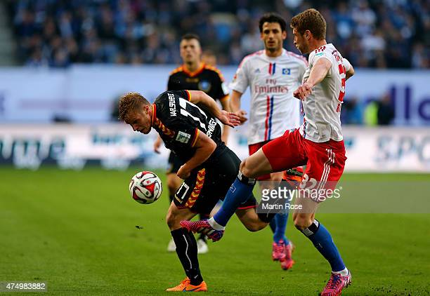 Slobodan Rajkovic of Hamburg and Rouwen Hennings of Karlsruhe battle for the ball during Bundesliga first leg play off match between Hamburger SV and...