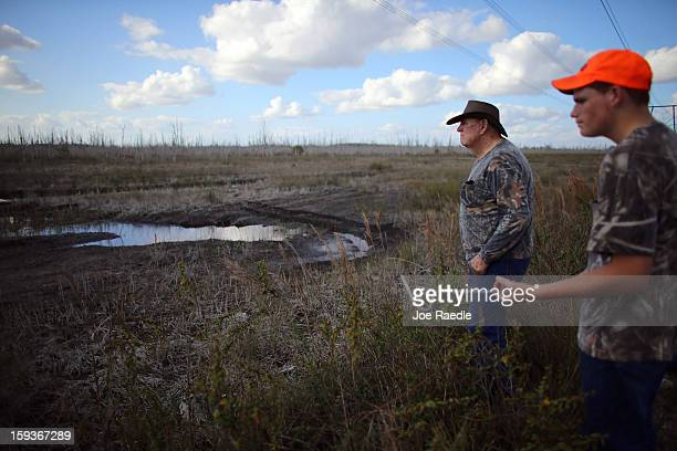 Slocum and his grandson Kyle Storch hunt for python's in the Florida Everglades on the first day of the 2013 Python Challenge on January 12 2013 in...