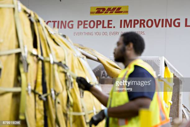 A slogan is displayed on a wall at a DHL Worldwide Express facility ahead of Cyber Monday in Chicago Illinois US on Sunday Nov 26 2017 Ecommerce...