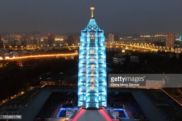 Slogans of paying tribute to medical workers are seen on illuminated Dabaoen Temple a landmark architecture in Nanjing on International Nurses Day on...