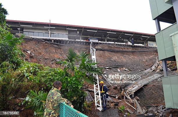 A slope beside the railway track of Keisei Narita Station is destroyed by a landslide as Typhoon Wipha approaching on October 16 2013 in Narita Chiba...